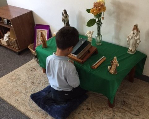 student reflects quietly at the prayer table